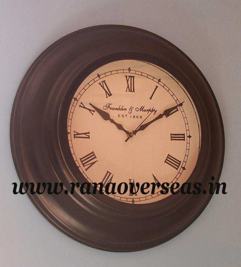 Wall Hanging Metal Clock in 16 Inches.